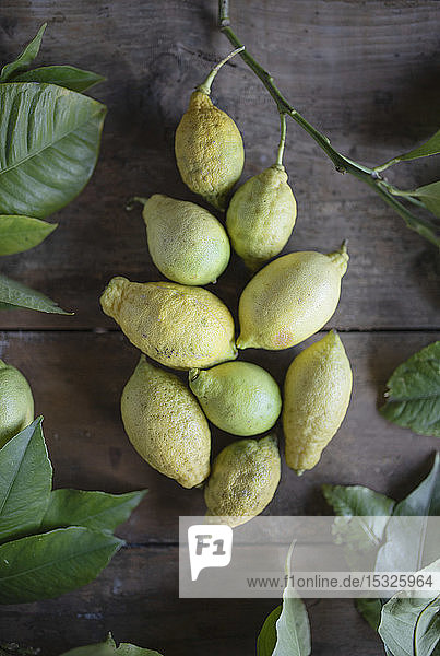 Organic lemons on a rustic wooden table