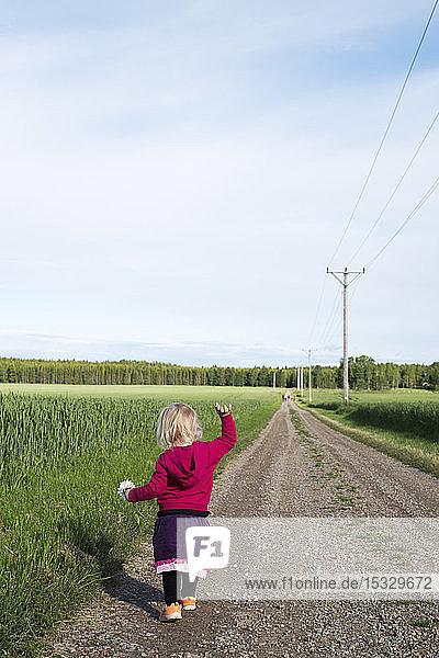 Girl walking on dirt road