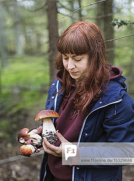 Woman holding mushroom