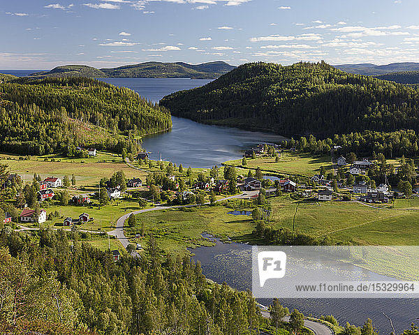 Town by forest and river in High Coast  Sweden Town by forest and river in High Coast, Sweden