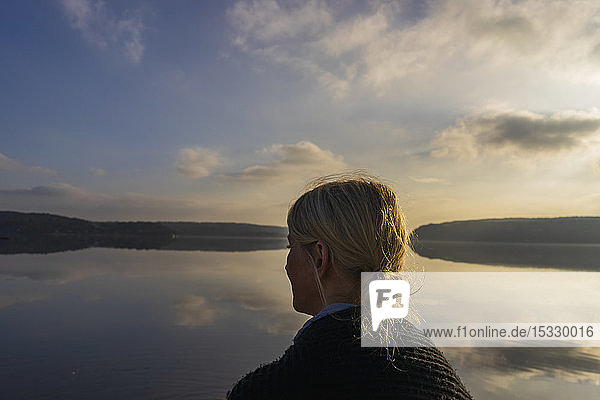 Mid adult woman in front of Lake Aspen in Lerum  Sweden