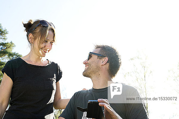 Couple smiling with smart phone