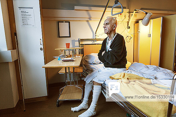 Senior man on hospital bed