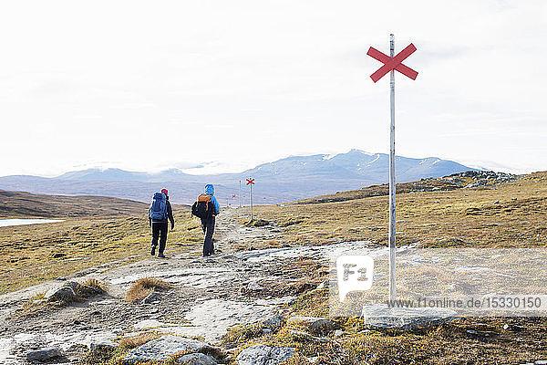 Women hiking through field Women hiking through field