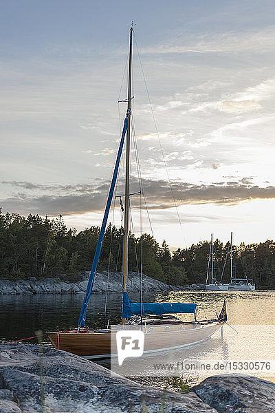 Moored boat at Stockholm archipelago during sunset