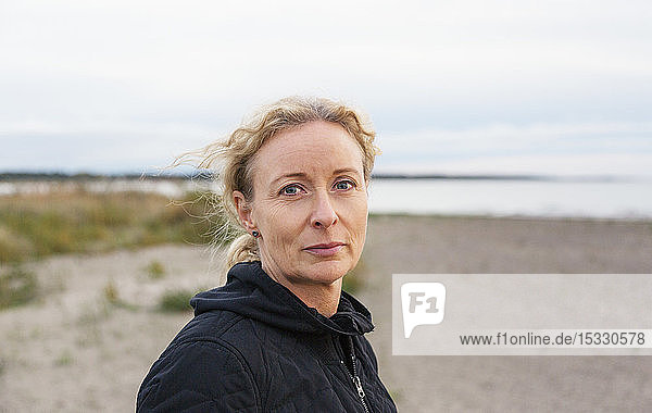 Portrait of mature woman on beach
