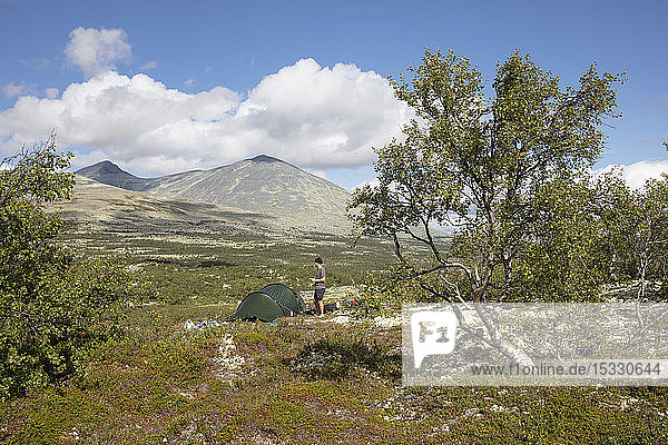 Man by his tent in Rondane National Park  Norway