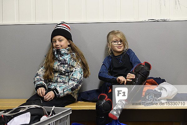 Girls in changing room prepare for ice hockey training Girls in changing room prepare for ice hockey training