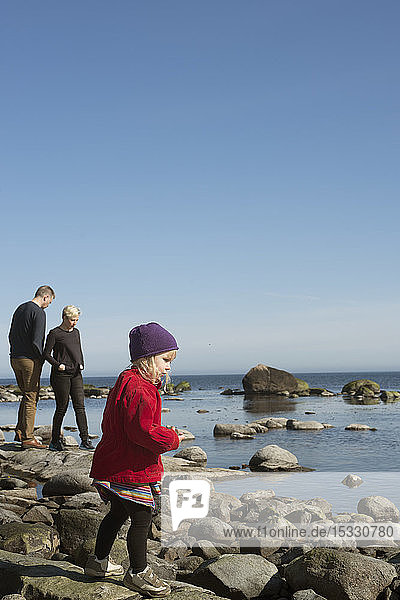 Parents with daughter on rocks