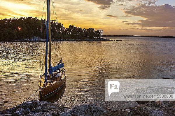 Moored boat at Stockholm archipelago during sunset Moored boat at Stockholm archipelago during sunset