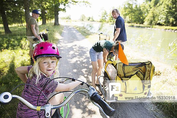 Family cycling by canal