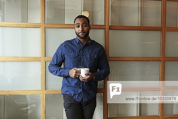 Portrait of businessman with coffee cup