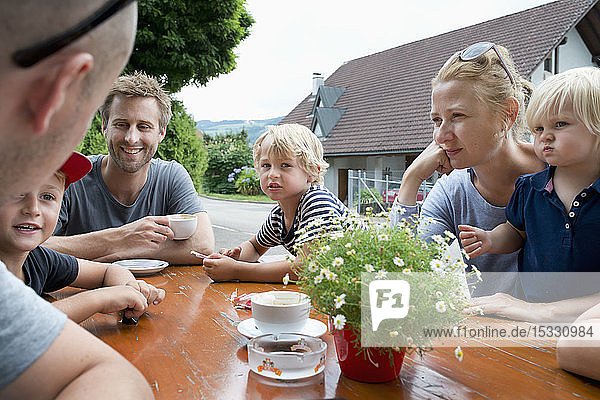 Family sitting at outdoor table