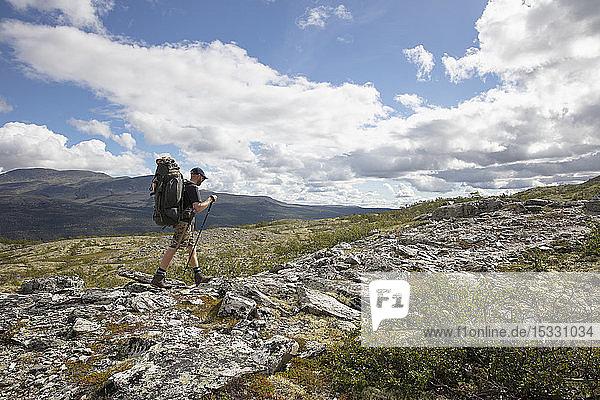 Man hiking in Rondane National Park  Norway