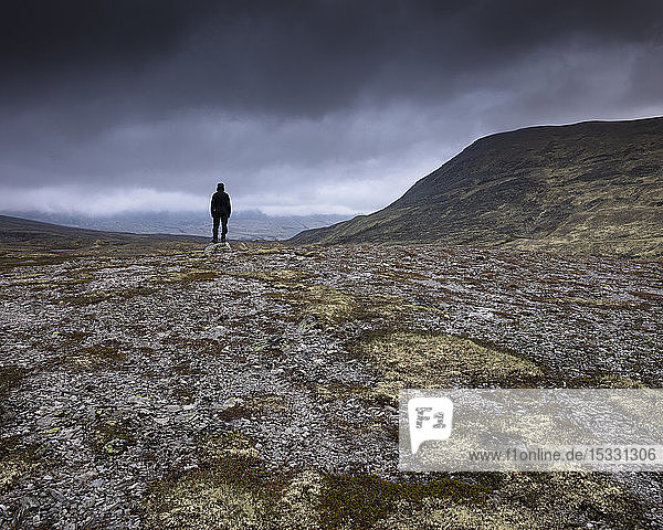 Man standing in Rondane National Park  Norway