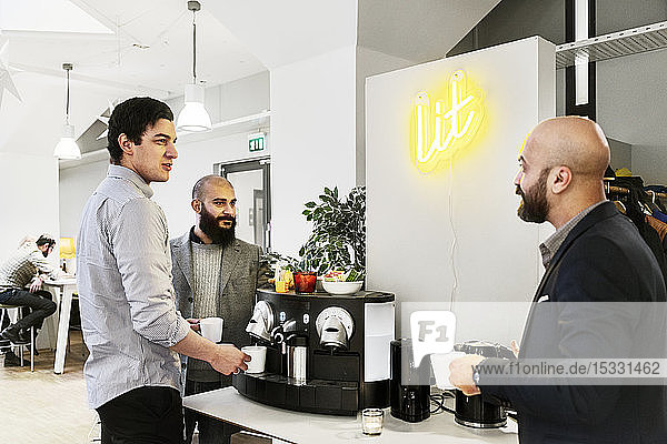 Men getting coffee in office