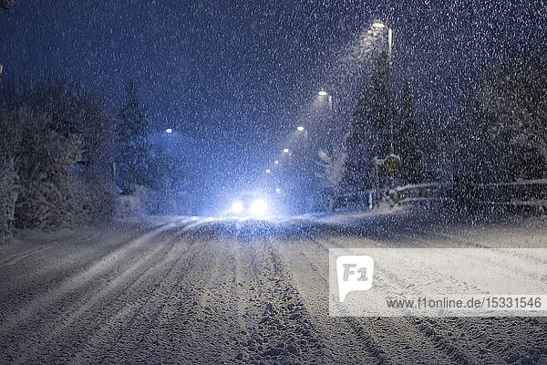 Headlights of car on snowy road at night Headlights of car on snowy road at night