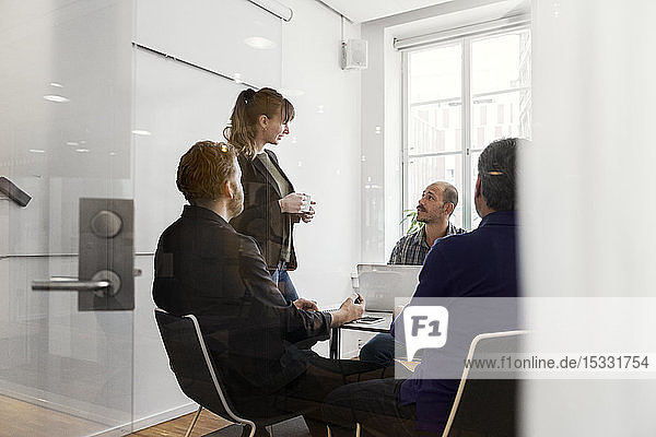 Businesspeople during meeting Businesspeople during meeting