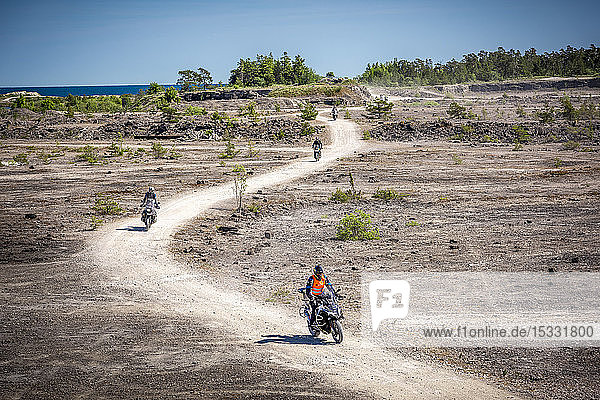 Motorcyclists on dirt road