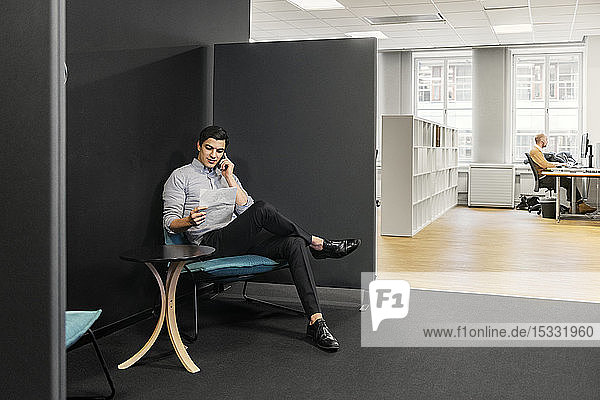 Young man on phone in office