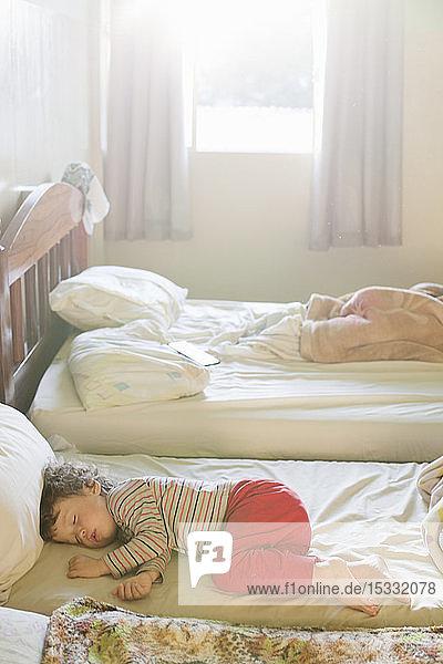 Boy sleeping on bed Boy sleeping on bed
