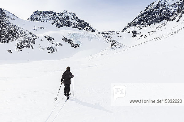 Woman skiing by on Kenekaise mountain in Lapland  Sweden
