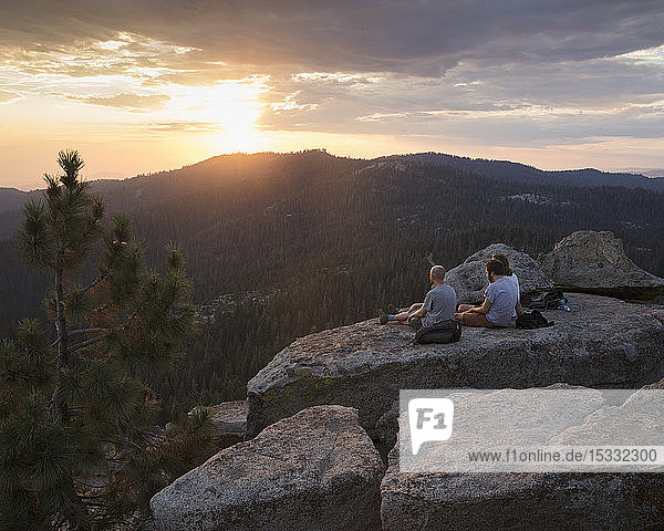 Men on rock at sunset in Sequoia National Park in California
