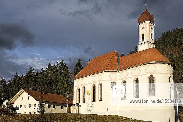 Austria  Tyrol. Naturparkregion Reutte  Pinswang St. Ulrich parish church  Constructed by the Baroque constructor Johann Fischer from Fussen
