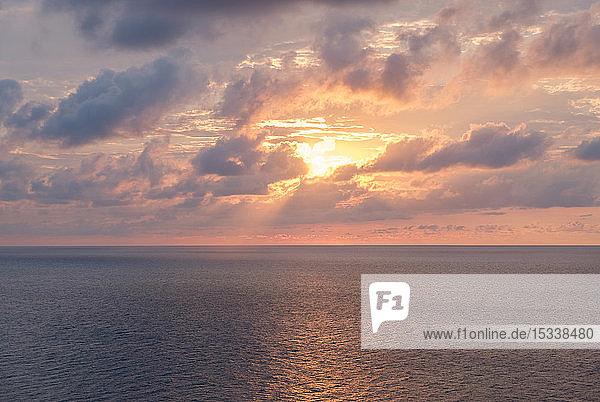 Sunrise cloudscape over sea