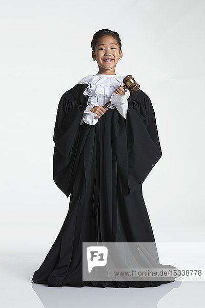 Teenage girl dressed as judge