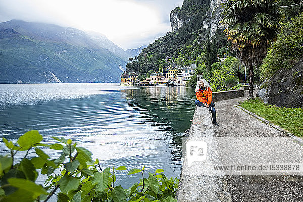 Woman on waterfront in Riva del Garda  Italy
