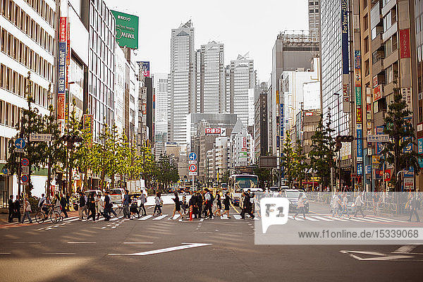 People walking on pedestrian crossing in tokyo