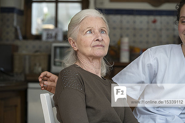Senior woman squinting eyes