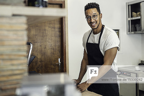 Portrait of man standing in commercial kitchen