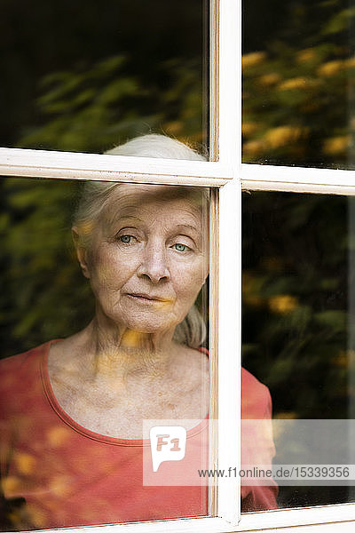 Woman looking through window