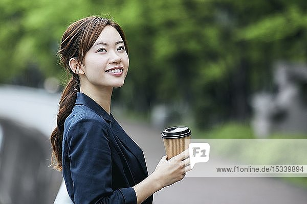 Young Japanese businesswoman downtown
