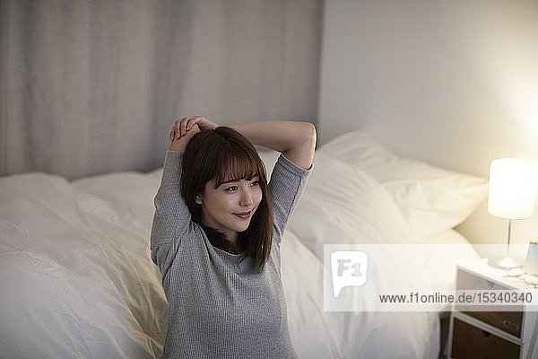 Young Japanese woman in the bedroom