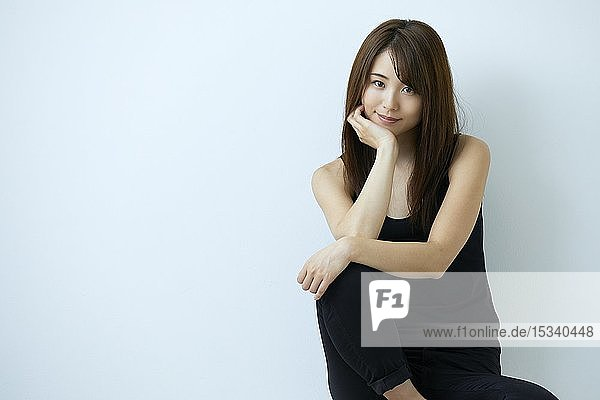 Studio portrait of attractive young Japanese woman