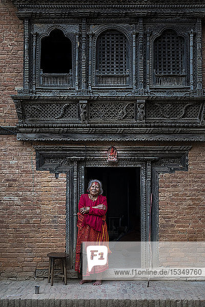 Traditional decorative Newari hand carved wood windows and architecture on a temple in an historical little village  Nuwacot  Nepal  Asia