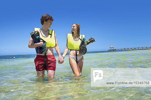 Loving couple going snorkeling  Roatan  Honduras  Caribbean  Central America