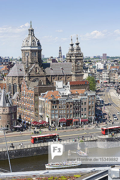 High angle view of central Amsterdam with St. Nicholas Church and tower  Amsterdam  North Holland  The Netherlands  Europe