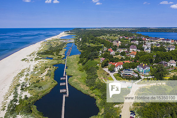 Aerial by drone of a boardwalk in a little lake on the coast of Yantarny  Kaliningrad  Russia  Europe