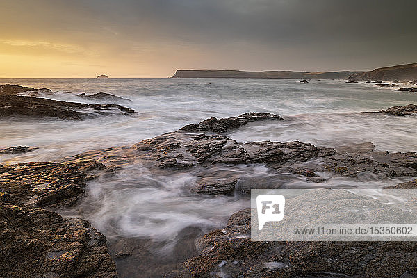 Waves swirl over rocky ledges at sunset on the North Cornwall coast  Cornwall  England  United Kingdom  Europe