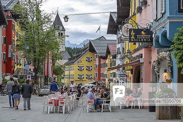 View of visitors enjoying drinks outside cafe on Vorderstadt  Kitzbuhel  Austrian Tyrol Region  Austria  Europe