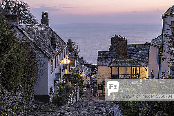 Pink dawn sky above the pretty village of Clovelly on the North Devon coast  Clovelly  England  United Kingdom  Europe