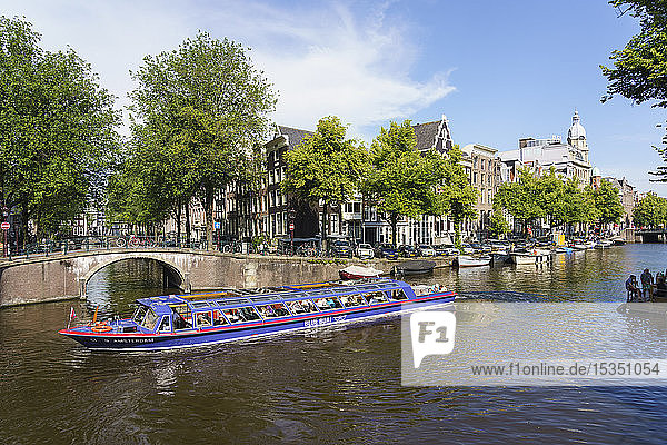 Tourist boat on a canal  Amsterdam  North Holland  The Netherlands  Europe