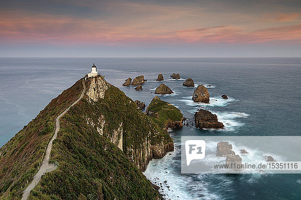 Nugget Point lighthouse at sunset  Kaka Point  Otago  South Island  New Zealand  Pacific