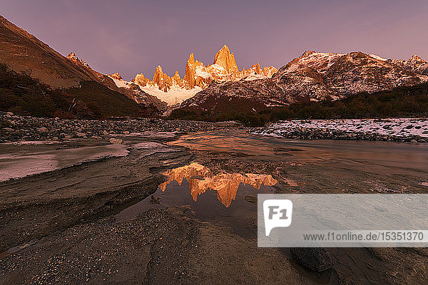 Mountain range with Cerro Torre and Fitz Roy at sunrise reflected  Los Glaciares National Park  UNESCO World Heritage Site  El Chalten  Patagonia  Argentina  South America
