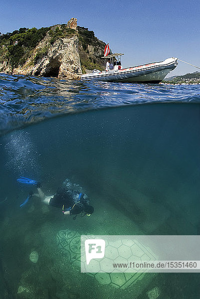 Diver swimming over a submerged Roman mosaic and ancient temple  water surface above  Campi Flegrei (Phlegraean Fields)  Campania  Italy  Mediterranean  Europe