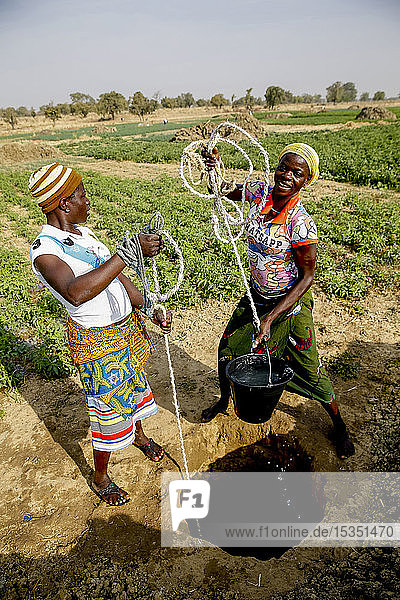 Women fetching water in Namong  Tone district  Togo  West Africa  Africa